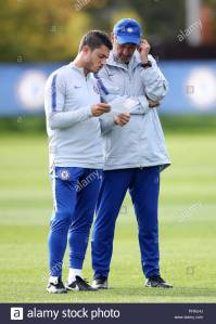 chelsea-assistant-coach-davide-losi-left-and-manager-mauricio-sarri-during-a-training-session-at-cobham-training-ground-london-restrictions-use-subject-to-restrictions-written-editorial-